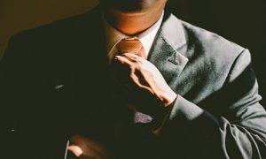 Man straightening tie image