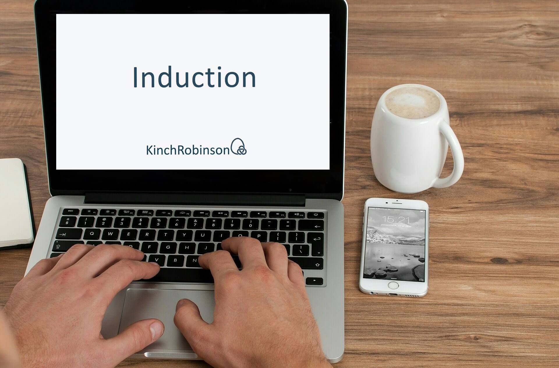 new law firm employee viewing online induction training on laptop